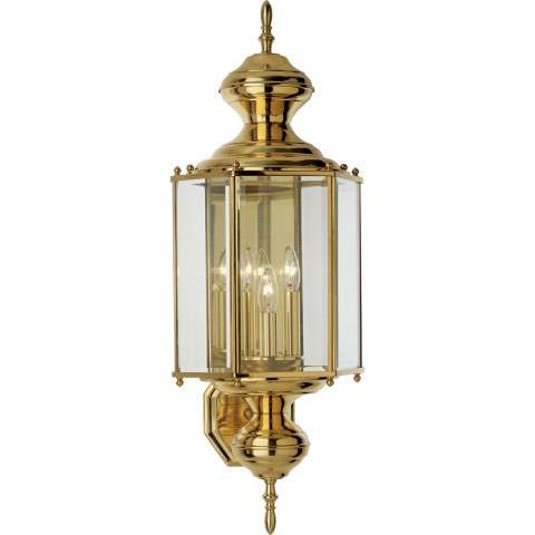Progress P5730-10 Three-light wall lantern in Polished Brass finish with clear beveled glass.